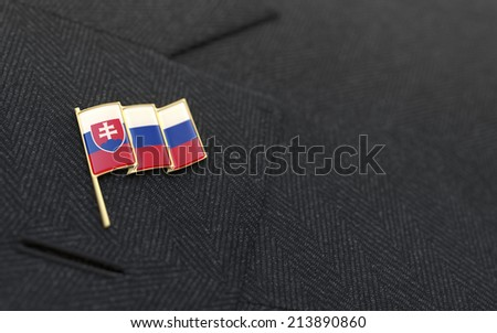 Slovakia flag lapel pin on the collar of a business suit jacket shows patriotism