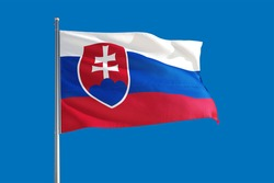 Slovakia national flag waving in the wind on a deep blue sky. High quality fabric. International relations concept.