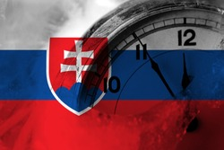 Slovakia, Slovakian flag with clock close to midnight in the background. Happy New Year concept