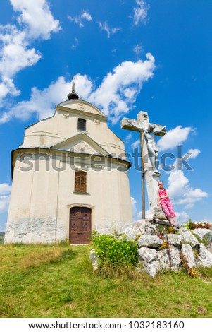 Slovakia - The Holy cross baroque chapel on the hill Siva brada in Spis region and little girl.