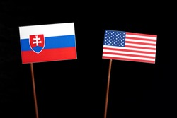 Slovakian flag with USA flag isolated on black background