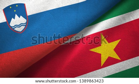 Slovenia and Suriname two flags textile cloth, fabric texture #1389863423