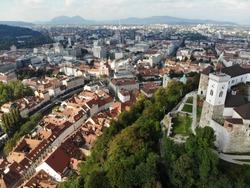 Slovenia caste mountaintop in city view