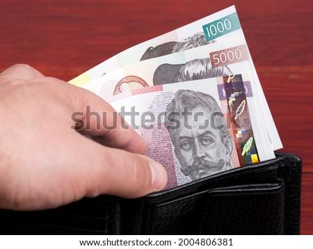Slovenian money - tolar in the black wallet Stock fotó ©