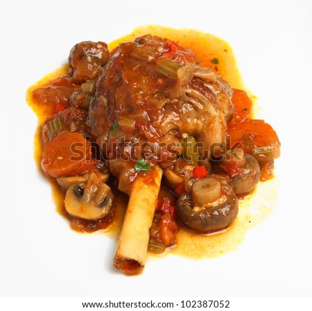 Slow cooked lamb shank with vegetables