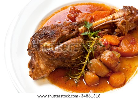 Slow-cooked lamb shank with vegetables.  Delicious, homely goodness.