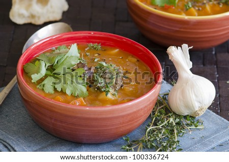 Slow-cooked lamb with root vegetable soup in a bowl