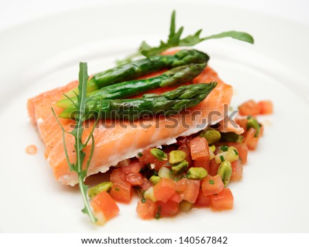 Slow cooked salmon steak in plate with vegetables