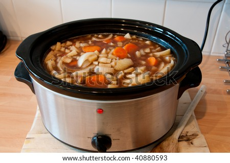 Slow cooker cooking Scouse with the lid off showing the stew cooking, cheep winter cooking - stock photo