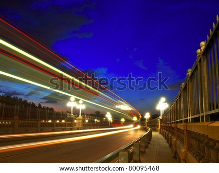 Slow exposure traffic view of the Colorado Street Bridge in Pasadena, California under a beautiful blue hour.