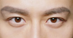 slow motion of male eye close up from asian young man