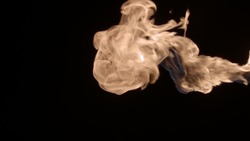 Slow-motion video of fire and flames. A fire pit, burning gas or gasoline burns with fire and flames. A hellish glow of fire in the dark with copy space