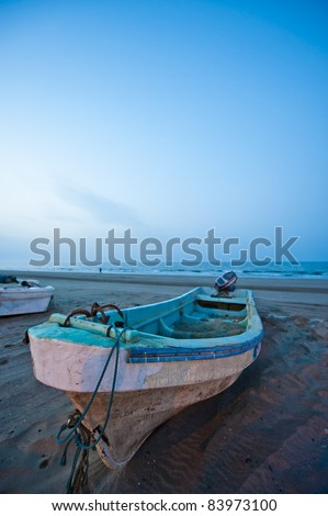 Slow shutter evening shot of a fishing boat on a beach in the Seeb area in Oman.