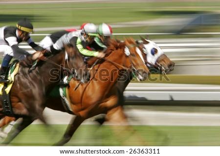 Slow shutter speed rendering of racing jockeys and horses - stock photo