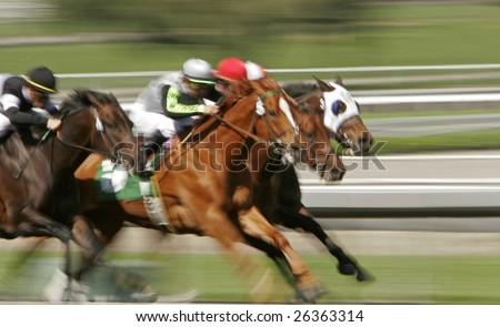 Slow shutter speed rendering of racing jockeys and horses - stock photo