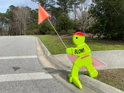 Slow sign at school areas to warn drivers to slow down!