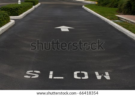 Slow sign on the road