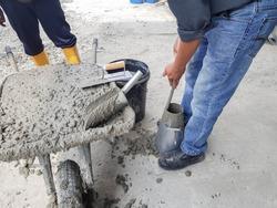 Slump test for fresh concrete to determine work-ability of the concrete.