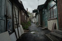 Slums of Russia. Old poor street in the rain. The resort city of Russia Kislovodsk. Rain in a poor quarter.