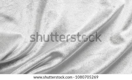 Slver white velvet background or velour flannel texture made of cotton or wool with soft fluffy velvety satin fabric cloth metallic color material in wavy satin pattern