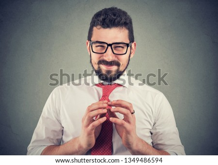 Sly business man in glasses looking at camera plotting a revenge  Stock fotó ©