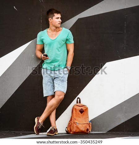 Slylish fashion man traveling with a bag #350435249