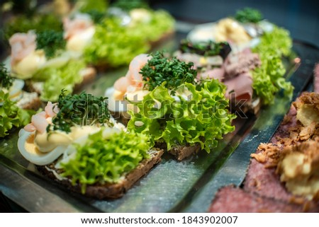 Smørrebrød traditional danish open faced sandwich with lettuce,ham, remoulade sauce and egg on dark rye bread and butter scandinavian cuisine Stockfoto ©