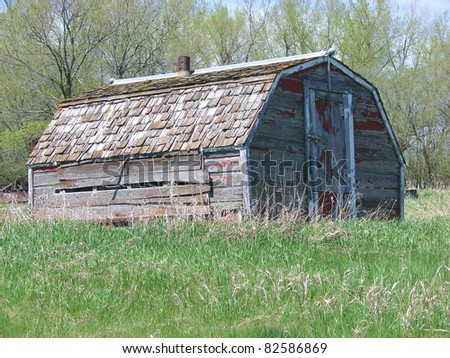 small abandoned farm building