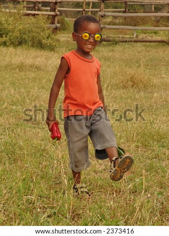 small  African boy at the farm in the village, near Kalahari border.