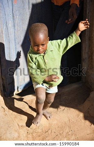 Small African child crying and running away from his parent