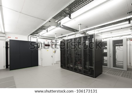small air-conditioned  computer server room environment with racks
