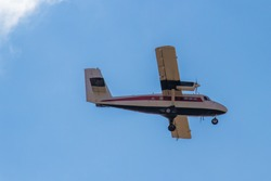 Small aircraft in the blue sky