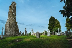 Small ancient cemetery and ruined church tower. Celtic style gravestones. Graveyard in Retaine, County Meath, Ireland
