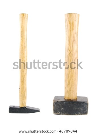 small and big wooden hammers isolated on white background