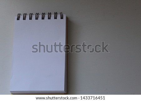 small and blank notepad. blank sheet #1433716451
