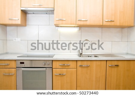 Small and modern kitchen in a new apartment.
