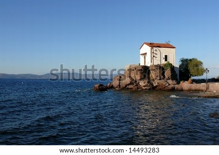 Small and romantic chapel at the seaside. Lesvos island, Greece