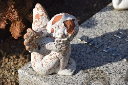 Small angel sculpture on a grave