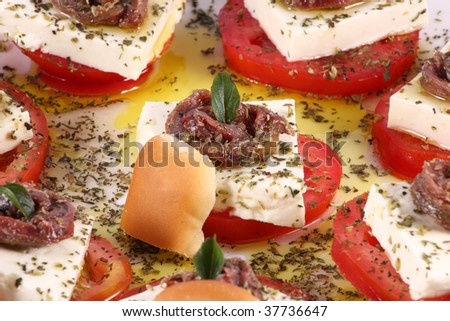 Small aperitifs with anchovy, cheese, tomato, bread and spices