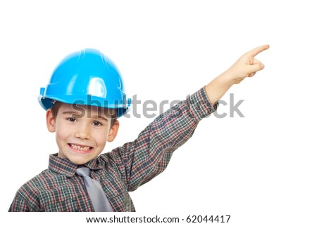 Small architect boy with helmet pointing up to copy space and smiling with his missing teeth isolated on white background
