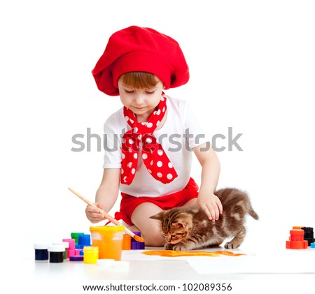 small artist child painting with brush. Kitten looking girl