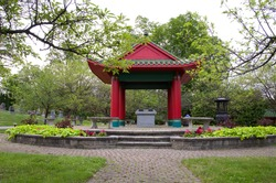Small Asian Oriental Red Temple with Flowers in Cemetery Horizontal