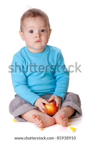 Small baby holding red apple. Isolated on white