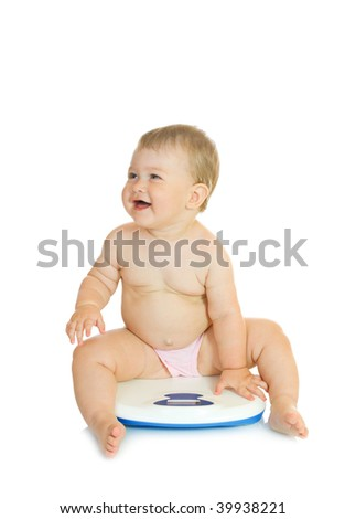 Small baby on home scales isolated