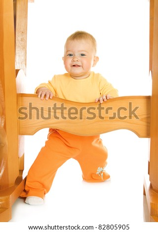 Small baby staying with table isolated