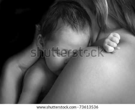 Small beautiful chaild on the mothers hands