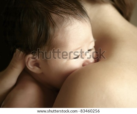 Small beautiful child on the mothers hands