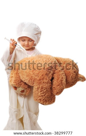 small beautiful girl playing doctor and healing taddy bear