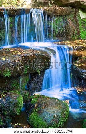 small beautiful waterfall - stock photo