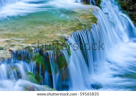 small beautiful waterfall on a mountain river